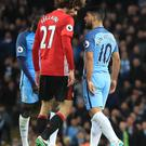 Manchester United's Marouane Fellaini (left) squares up to Manchester City's Sergio Aguero, and head butt was not long in coming