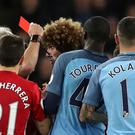 Manchester United's Marouane Fellaini reacts after being sent off