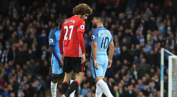 Marouane Fellaini was sent off after clashing with Sergio Aguero