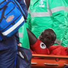 Mamadou Sakho was taken off on a stretcher after suffering a knee injury in Crystal Palace's loss to Tottenham