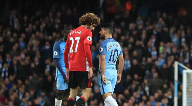 Manchester United's Marouane Fellaini (left) was sent off for headbutting Manchester City's Sergio Aguero
