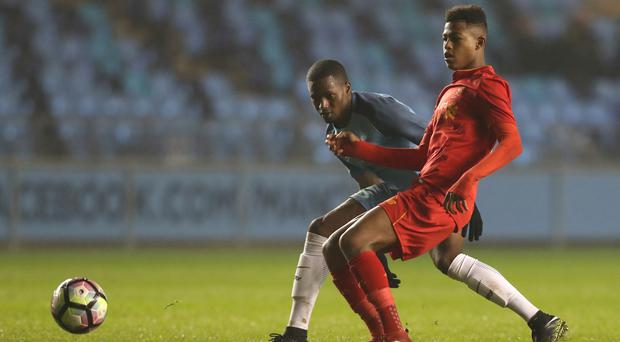 Liverpool academy striker Rhian Brewster (right) will probably have to wait for his Premier League debut.