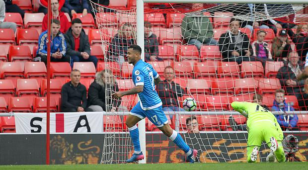 Joshua King wheels away after scoring the goal that sent Sunderland down