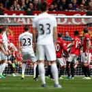 Swansea's Gylfi Sigurdsson (23) scores his side's goal