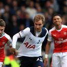 Christian Eriksen, pictured centre, starred for Spurs against Arsenal