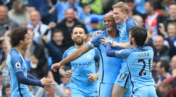 Vincent Kompany, centre, celebrates his goal with his City teammates. Photo: PA Wire