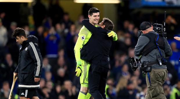Thibaut Courtois, pictured left with Antonio Conte, is getting ready to savour Premier League glory