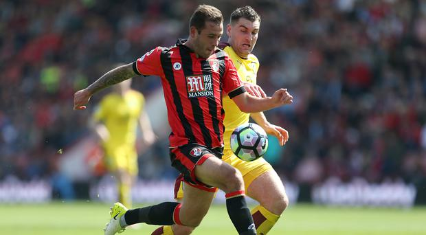 Defender Steve Cook, left, hopes Bournemouth can end the season with another win