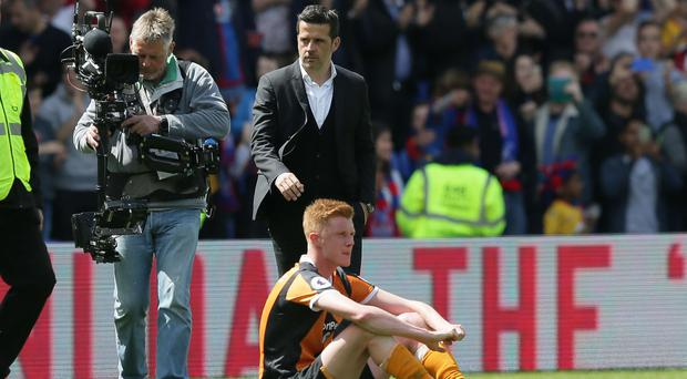 Hull manager Marco Silva, pictured top, saw his side relegated from the Premier League