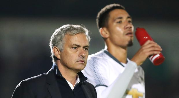 Chris Smalling, right, looks set to leave Manchester United