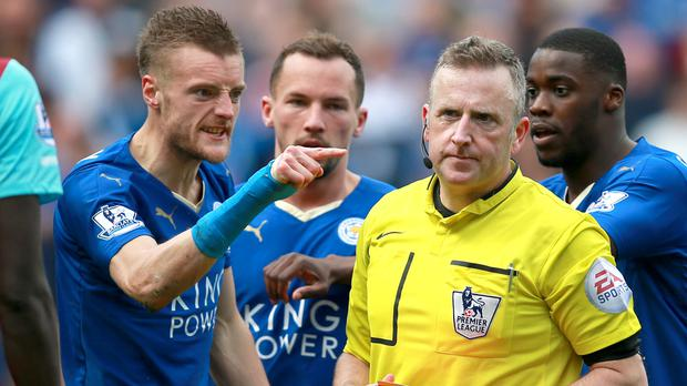 Leicester's Jamie Vardy, pictured left, was shown a second yellow card for diving against West Ham in April