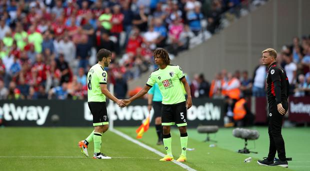 Nathan Ake, pictured centre, is a reported summer target for Bournemouth manager Eddie Howe, right