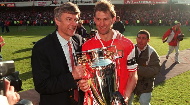 Former Arsenal captain Tony Adams, right, has questioned the coaching capabilities of manager Arsene Wenger