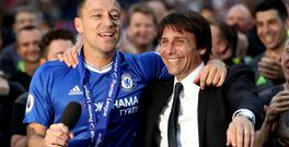 Antonio Conte, right, celebrates with departing defender John Terry