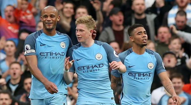 Kevin De Bruyne, centre, led the Premier League in assists and shots against the woodwork
