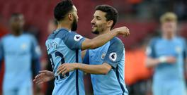 Gael Clichy, left, and Jesus Navas, right, are among the players leaving Manchester City this summer
