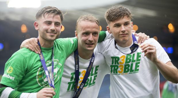 Patrick Roberts, celebrates at Hampden with Leigh Griffiths and Kieran Tierney