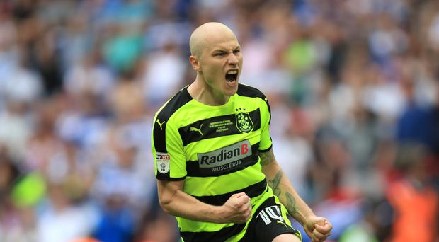 Aaron Mooy helped Huddersfield to a historic promotion
