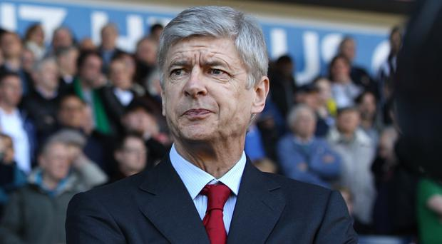 Wenger in! Signs new two-year contract