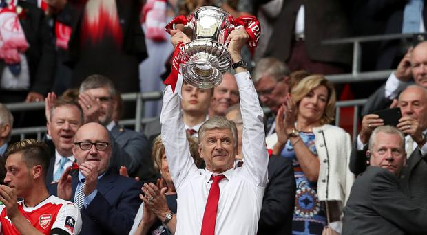 Arsene Wenger lifts the FA Cup after victory over Chelsea