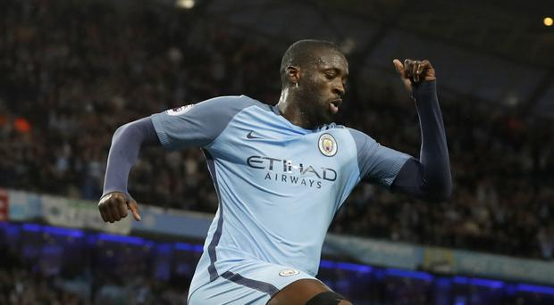 Yaya Toure is celebrating signing a one-year confract extension with Manchester City