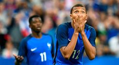 Kylian Mbappe reacts after missing a chance for France. Photo: Getty Images