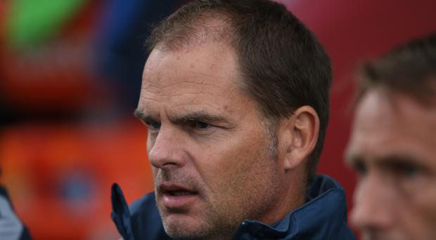 Southampton are looking at Frank de Boer as a possible successor to Claude Puel