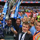 Dean Hoyle is pictured with jubilant Huddersfield fans at Wembley