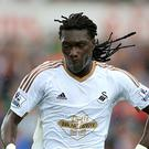 Swansea striker Bafetimbi Gomis is set to join Turkish club Galatasaray.