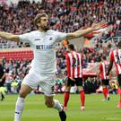 Swansea striker Fernando Llorente has broken his arm while on a family holiday