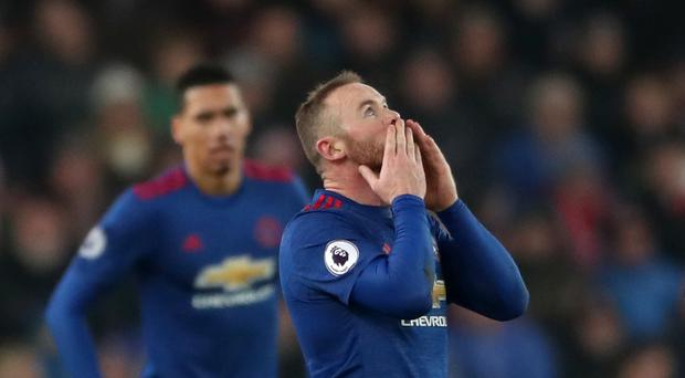 Wayne Rooney celebrates his record-breaking goal for Manchester United at Stoke