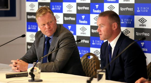 Ronald Koeman, left, is confident Wayne Rooney can help end Everton's trophy drought