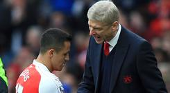 Arsene Wenger (right) want to keep Alexis Sanchez at Arsenal