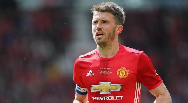 Michael Carrick will take on captain's responsibilities this season