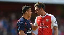 Mesut Ozil, right, and Alexis Sanchez are out of contract next year