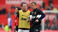 Phil Neville, right, has backed Wayne Rooney to gel Everton's new-look side together