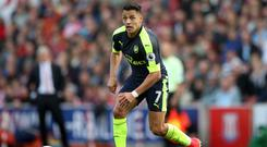 Alexis Sanchez has been out with an abdominal injury