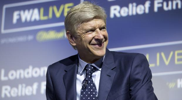 Arsenal manager Arsene Wenger admits uncertainty over his future last season filtered through to the dressing room