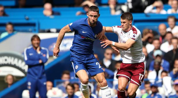 Chelsea captain Gary Cahill (left) was sent off against Burnley