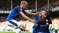 Wayne Rooney celebrates scoring for Everton