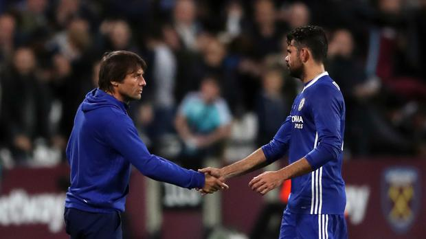 Diego Costa, pictured right, claims Antonio Conte, left, told him he was surplus to requirements at Chelsea by text message