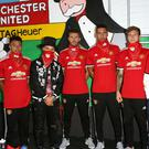 Manchester United players met graffiti artist Alec Monopoly at Old Trafford for the unveiling of a mural (TAG Heuer)