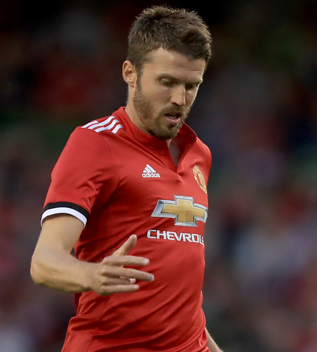 Manchester United's Michael Carrick is captain of the Old Trafford club this season Photo: PA News