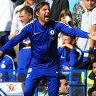 Chelsea head coach Antonio Conte, left, has laughed off criticism from striker Diego Costa