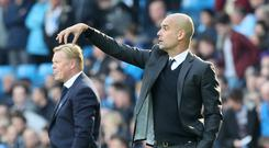 Pep Guardiola (right) faces his former team-mate Ronald Koeman on Monday