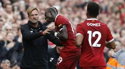 Sadio Mane celebrates his goal with Jurgen Klopp