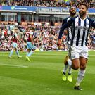 Hal Robson-Kanu celebrates his goal just before he was sent off