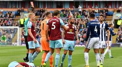 Match-winner Hal Robson-Kanu, right, is shown the red card at Turf Moor