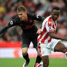 Aaron Ramsey, left, tussles with Stoke striker Saido Berahino