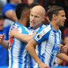Aaron Mooy, centre, led Huddersfield to a second successive Premier League win